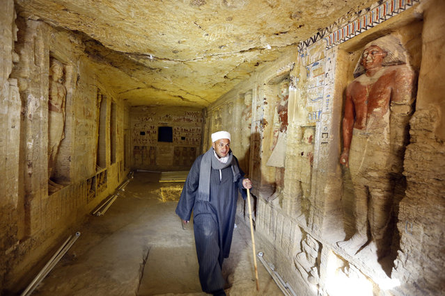 "Mustafa Abdo, chief of excavation workers walks at a recently uncovered tomb of the Priest royal Purification during the reign of King Nefer Ir-Ka-Re, named ""Wahtye"", at the site of the step pyramid of Saqqara, in Giza, Egypt, Saturday, December 15, 2018. The Egyptian Archaeological Mission working at the Sacred Animal Necropolis in Saqqara archaeological site succeeded to uncover the tomb, Antiquities Minister Khaled el-Anani, announced. (Photo by Amr Nabil/AP Photo)"