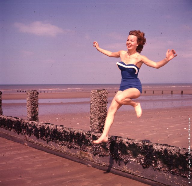 Marianne Brauns jumping a breakwater on the beach