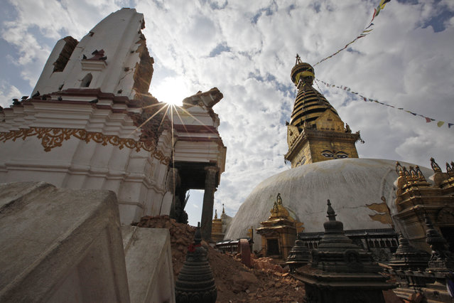 This Thursday, April 30, 2015 photo, shows a view of the famous Swayambhunath stupa after it was damaged in the April 25 massive earthquake in Kathmandu, Nepal. (Photo by Niranjan Shrestha/AP Photo)