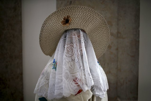 """A member of the """"Mozos de Jaen"""" folk group poses for a portrait before the parade of the 10th International Festival of the Iberian Mask in Lisbon, Portugal May 9, 2015. (Photo by Rafael Marchante/Reuters)"""