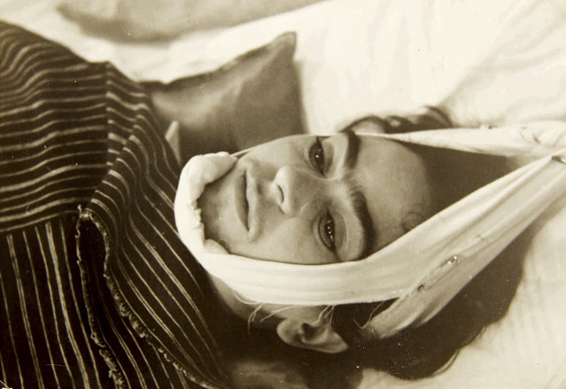 This 1940 photo provided by Sotheby's shows artist Frida Kahlo with her head suspended by straps. The image is part of a collection of photographs by Nicholas Muray up for auction on Friday, April 5, 2019. (Photo by Nickolas Muray via Sothebys via AP Photo)