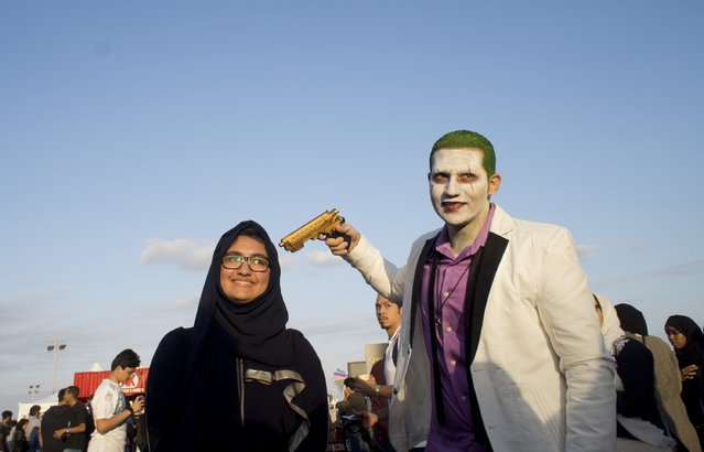 A visitor poses for picture with a man disguised as The Joker, during the Saudi Comic Con (SCC) which is the first event of its kind to be held in Jiddah, Saudi Arabia, Friday, February 17, 2017. (Photo by AP Photo)