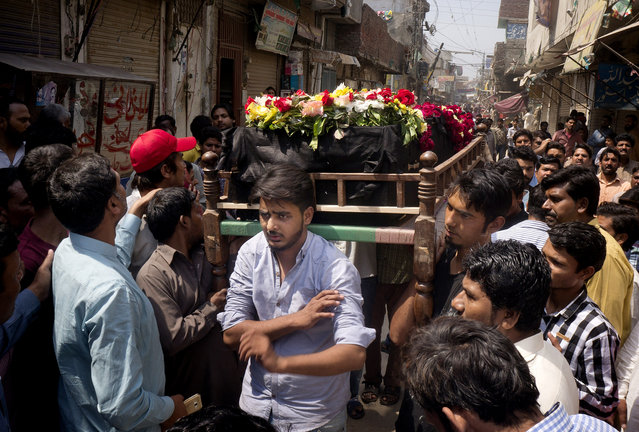 People prepare to burry the body of Christian man killed in bomb attack in Lahore, Pakistan, Monday, March 28, 2016. The death toll from a massive suicide bombing targeting Christians gathered on Easter in the eastern Pakistani city of Lahore rose on Monday as the country started observing a three-day mourning period following the attack. (Photo by B.K. Bangash/AP Photo)