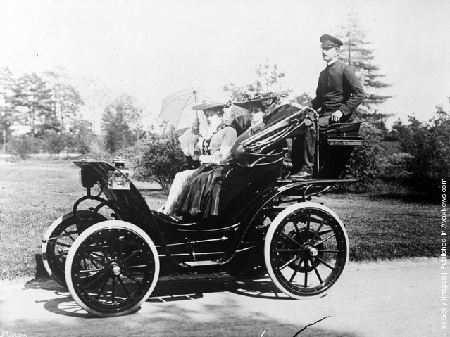 Two Victorian ladies out for a drive with their chauffeur