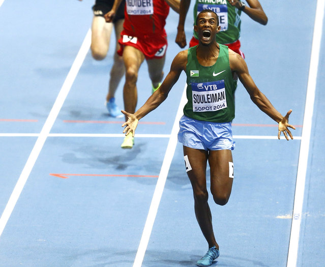 Ayanleh Souleiman of Djibouti celebrates as he wins the men's 1500 metres final at the world indoor athletics championships at the ERGO Arena in Sopot March 8, 2014. (Photo by Kacper Pempel/Reuters)