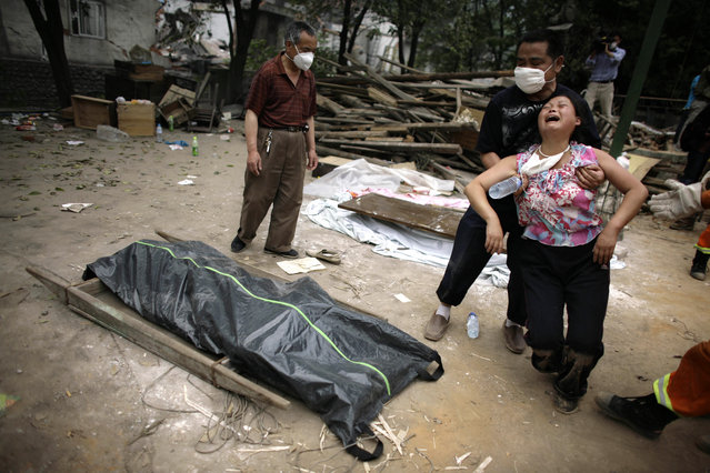 A woman mourns over the body of  her relative in Hanwang town, in China's southwest Sichuan province, on Friday, May 16, 2008. (Photo by Oded Balilty/AP Photo)