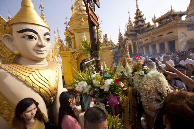 Myanmar Buddhist devotees pour water on a Buddha statue as they visit Myanmar famous Shwedagon Pagoda during the Full Moon day of Kasone, known as Buddha's Birthday, Saturday, May 2, 2015, in Yangon, Myanmar. (Photo by Khin Maung Win/AP Photo)
