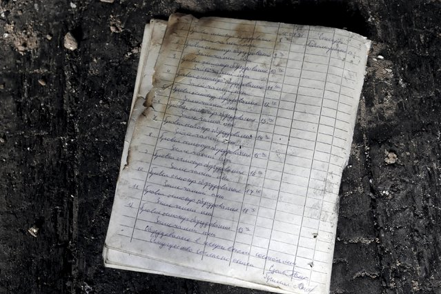 Soviet military notebook is seen on the floor of abandoned building in the ghost town of a former Soviet military radar station near Skrunda, Latvia, April 9, 2016. (Photo by Ints Kalnins/Reuters)