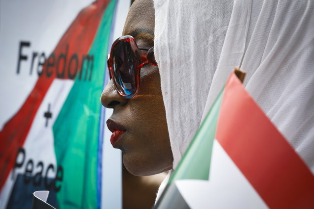 A Sudanese woman looks on during a protest against Sudan's crackdown on pro-democracy protesters, in Nairobi, Kenya, 19 June 2019. Some 100 people gathered in downtown Nairobi to mourn those who were killed by the Sudanese security forces in Khartoum on 03 June 2019. Kenyan police dispersed the gathering with tear gas. (Photo by Dai Kurokawa/EPA/EFE)