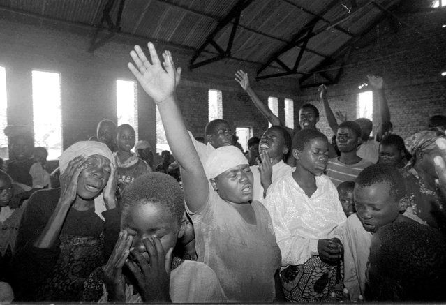 Rwandan refugees celebrate with song and prayer in a church in Kabiza, Rwanda, after returning from Mugunga camp in Goma, Zaire, for the first time in more than two years; 1996. (Photo by Carol Guzy/The Washington Post)