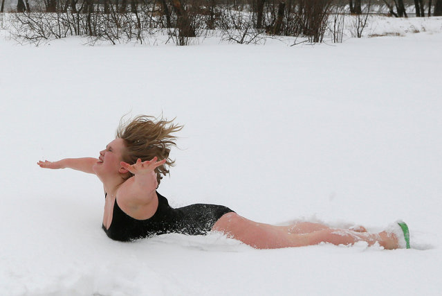 Galina Tiptsova, a model of the SibPlus Models agency and a participant of the Miss Doughnut beauty competition, jumps into the snow at the Polar Bear winter swimmers club in Krasnoyarsk, Siberia, Russia, March 4, 2017. (Photo by Ilya Naymushin/Reuters)