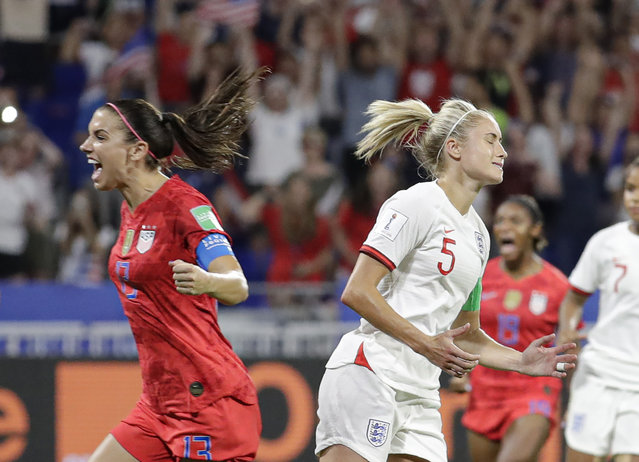 England's Steph Houghton, right, grimaces after failing to score from the penalty spot as United States' Alex Morgan celebrates during the Women's World Cup semifinal soccer match between England and the United States, at the Stade de Lyon, outside Lyon, France, Tuesday, July 2, 2019. (Photo by Alessandra Tarantino/AP Photo)