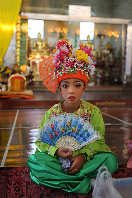 A Tai Yai boy poses for a portrait on April 7, 2014 in Mae Hong Son, Thailand. Poy Sang Long is a Buddhist novice ordination ceremony of the Shan people or Tai Yai, an ethnic group of Shan State in Myanmar and northern Thailand. Young boys aged between 7 and 14 are ordained as novices to learn the Buddhist doctrines. It's believed that they will gain merit for their parents by ordaining. (Photo by Taylor Weidman/Getty Images)