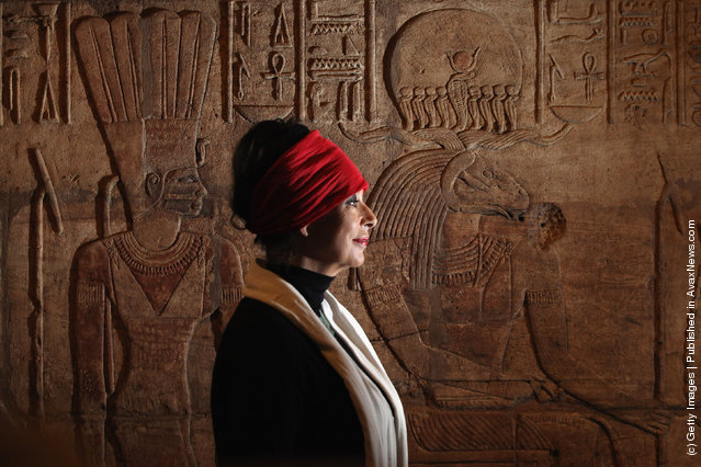 Artist Sue Goddard views detail on the Shrine of Taharqa in the Ashmolean Museum's new exhibition of artifacts from ancient Egypt and Nubia