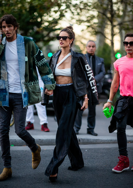 Model Alessandra Ambrosio wearing white cropped top, black leather jacket, wide leg pants Off White is seen outside Off White during Paris Fashion Week Womenswear Spring/Summer 2019 on September 27, 2018 in Paris, France. (Photo by Christian Vierig/Getty Images)