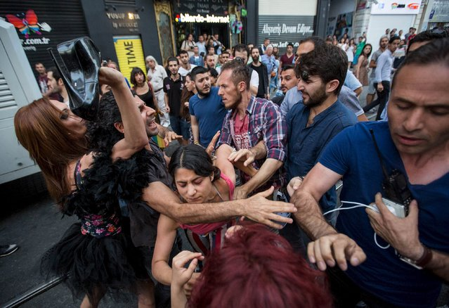 LGBT rights activists struggle with plainclothes police officers before a Gay Pride Parade in central Istanbul, Turkey, June 28, 2015. (Photo by Kemal Aslan/Reuters)
