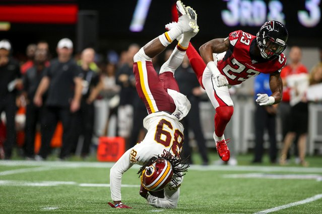 Washington Redskins wide receiver Cam Sims (89) is upended on a tackle by Atlanta Falcons defensive back Jayson Stanley (23) in Atlanta, Georgia, August 22, 2019. (Photo by Brett Davis/USA TODAY Sports)