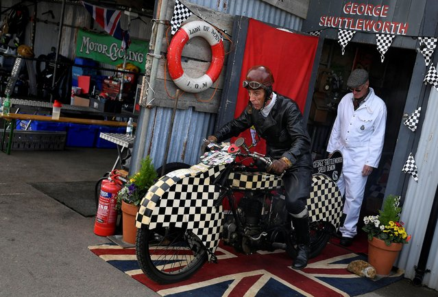 Motoring enthusiasts attend the Goodwood Revival, a three day classic car racing festival celebrating the mid-twentieth century heyday of the sport, at Goodwood in southern Britain, September 13, 2019. (Photo by Toby Melville/Reuters)