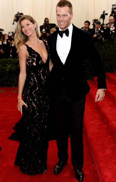 "Model Gisele Bundchen (L) and NFL player Tom Brady attend the ""Charles James: Beyond Fashion"" Costume Institute Gala at the Metropolitan Museum of Art on May 5, 2014 in New York City. (Photo by Dimitrios Kambouris/Getty Images)"