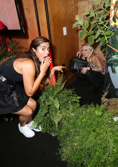 "Lorenza Izzo and Kirby Bliss Blanton seen at Eli Roth and BH Tilt ""The Green Inferno"" at 2015 Comic-Con on Thursday, July 9, 2015, in San Diego. (Photo by Eric Charbonneau/Invision for BH Tilt/AP Images)"