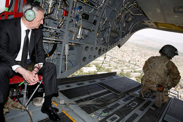 U.S. Defense Secretary James Mattis looks out over Kabul as he arrives via helicopter at Resolute Support headquarters in Kabul, Afghanistan April 24, 2017. (Photo by Jonathan Ernst/Reuters)