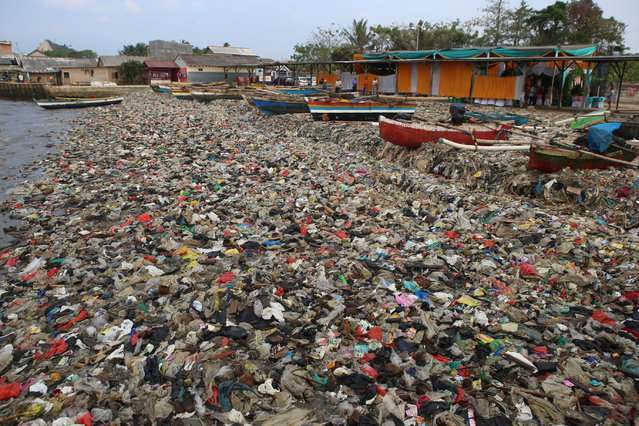 Plastic waste is seen choking Sukaraja beach in Bandar Lampung, Indonesia on September 8, 2019. (Photo by Perdiansyah/AFP Photo)