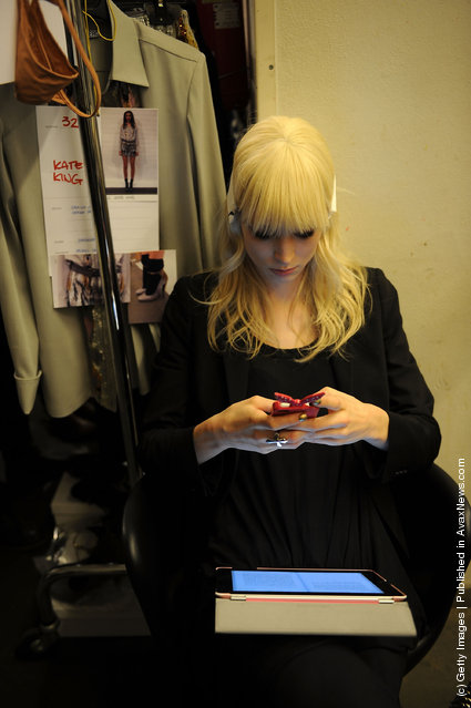 A model relaxes backstage at the Iceberg Autumn/Winter 2012/2013 fashion show as part of Milan Womenswear Fashion Week