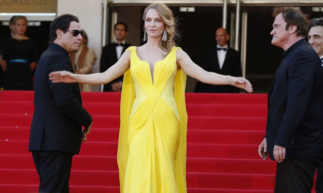 """Uma Thurman poses as she arrives with John Travolta and Quentin Tarantino for the screening of the film """"Sils Maria"""" at the 67th edition of the Cannes Film Festival in Cannes, France, May 23, 2014. (Photo by Valery Hache/AFP Photo)"""