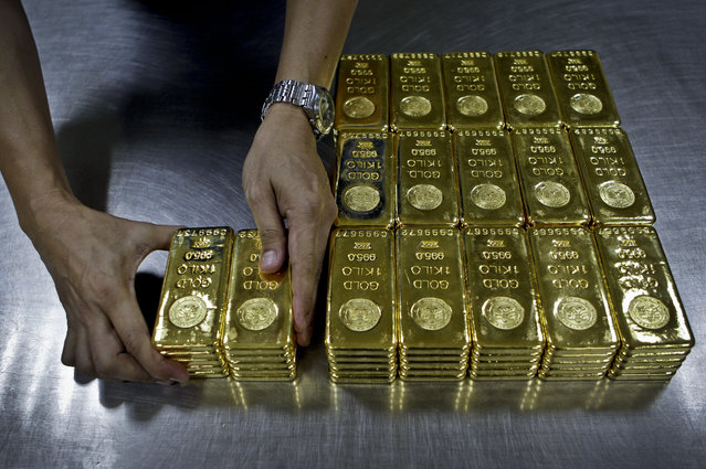 In this Tuesday October 9, 2012 file photo, a technician prepares 1 Kg  gold bars of 995.0 purity to pack for delivery at the Emirates Gold company in Dubai, United Arab Emirates. The price of gold, which is often seen as a hedge against inflation and a weak dollar, slumped to its lowest in five years on Monday, July 20, 2015. (Photo by Kamran Jebreili/AP Photo)