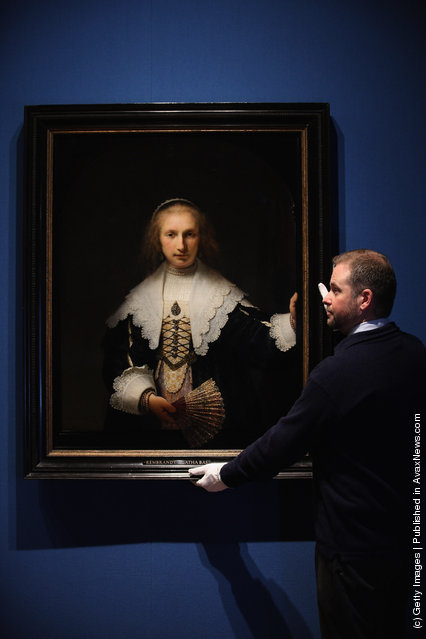 Stephen Webster, Exhibition co-ordinator, stands next to the painting Agatha Bas by Rembrandt, part of the Royal Collection