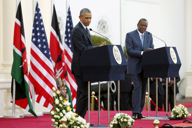 U.S. President Barack Obama (L) pauses during his remarks at a news conference with Kenya's President Uhuru Kenyatta after their meeting at the State House in Nairobi July 25, 2015. (Photo by Jonathan Ernst/Reuters)