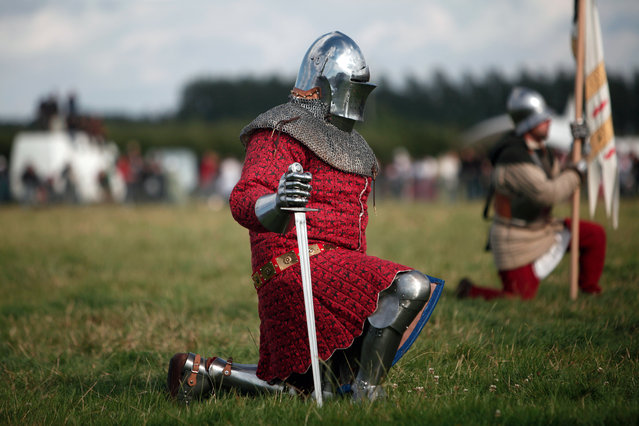 A man wearing an armor attends a reenactment of the Battle of Agincourt, in Agincourt, northern France, Saturday, July 25, 2015. (Photo by Thibault Camus/AP Photo)