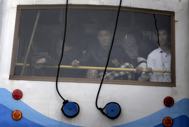 North Korean commuters ride on a city trolley bus, Sunday, May 3, 2015 in Pyongyang, North Korea. (Photo by Wong Maye-E/AP Photo)