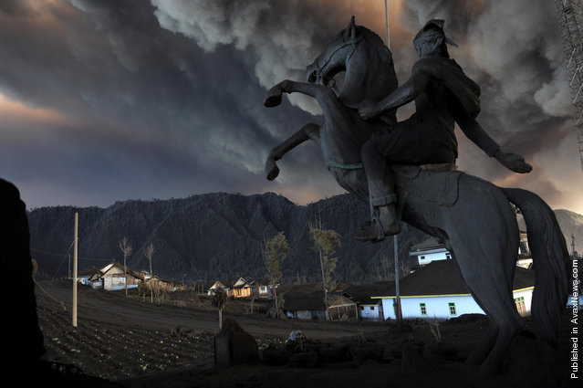 An ash-covered statue stands at the entrance to the village of Cemoro Lawang near the active Mount Bromo volcano in the east of Indonesia's central Java island early on December 24, 2010. Photo part of a series winning the 3rd prize for Nature Stories in the World Press Photo Contest