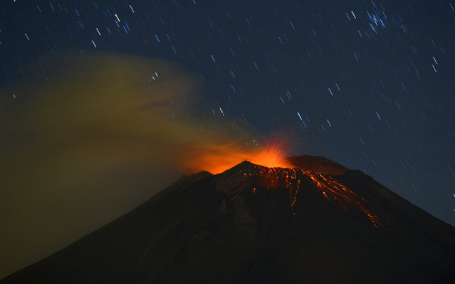 Incandescent materials, ash and smoke are spewed from the Popocatepetl Volcano as seen from Santiago Xalitzintla, in the Mexican central state of Puebla. Residents at the foot of Mexico's Popocatepetl volcano no longer sleep soundly since the towering mountain roared back into action over a week ago, spewing out a hail of rocks, steam and ashes. The volcano, Mexico's second highest peak at 5,452 metres, started rumbling and spurting high clouds of ash and steam on April 13, provoking the authorities to raise the alert to level five on a seven-point scale