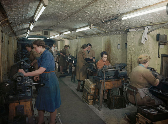 Women producing bullets and cannon shells in an underground munitions factory on the Wirral, Merseyside, 1945. (Photo by IWM/PA Wire)