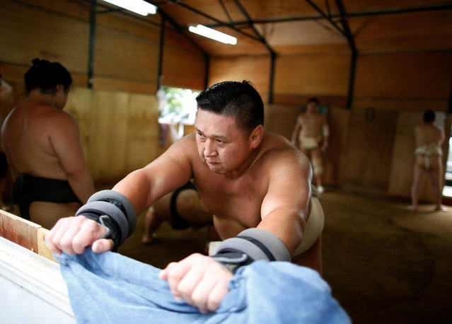 """Mongolian-born Tomozuna Oyakata attends his wrestlers' training session in Nagoya, Japan on July 18, 2017. But the tough training and tradition-bound ways have put off many local youth from the sport, leaving sumo to be dominated by foreign – mainly Mongolian – wrestlers, who face a gruelling path to assimilation. """"Language was the biggest source of stress"""", said Tomozuna Oyakata, better known by his fighting name Kyokutenho, the first Mongolian-born wrestler to lead a sumo stable. """"I couldn't understand anything when I was being scolded, or even when I was being praised"""", said the master, one of the first six Mongolians to be inducted into the sport in 1992. (Photo by Issei Kato/Reuters)"""