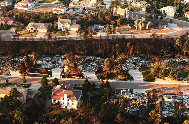Homes destroyed by the Waldo Canyon fire, seen from the air in a neighborhood of Colorado Springs, Colorado, on June 30, 2012. The massive fire, which has eased with the help of cooler temperatures and lighter winds, has destroyed hundreds of homes and forced more than 35,000 people to flee. (Spencer Platt)