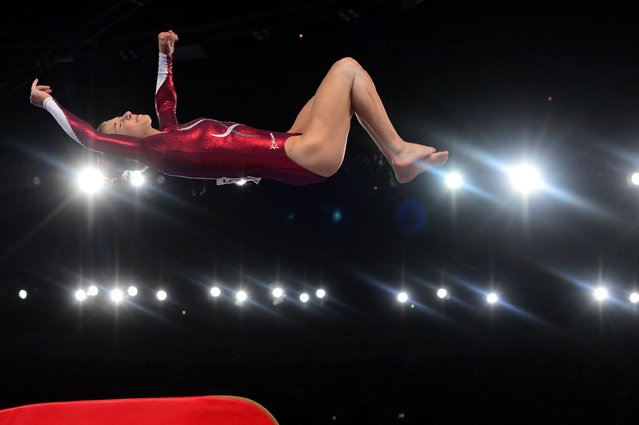 Kelly Simm of England performs in the women's vault final of the Artistic Gymnastics event during the 2014 Commonwealth Games in Glasgow, Scotland, on July 31, 2014. (Photo by Carl Court/AFP Photo)