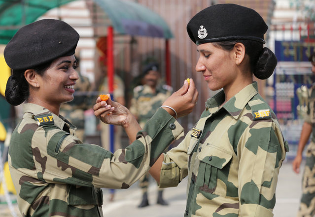 Indian Border Security Force (BSF), women soldiers offer sweets to each other as they celebrate on the occasion of India's Independence Day at India-Pakistan Joint Check Post (JCP) Attari, some 30 km from Amritsar, India, 15 August 2017. India is celebrating its 70th year of independence from British rule on 15 August 2017. (Photo by Raminder Pal Singh/EPA)