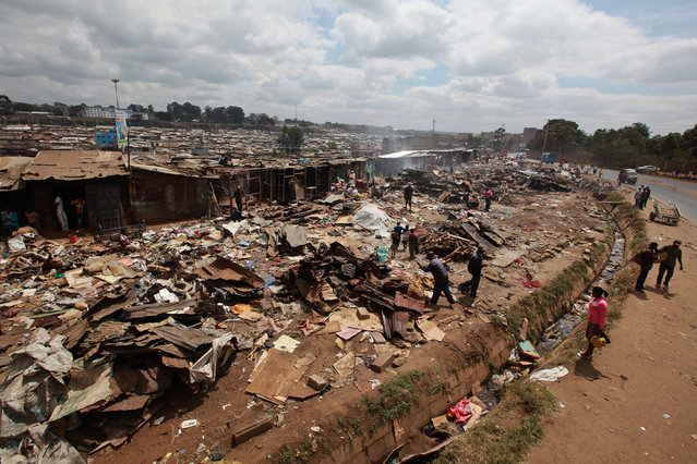 A general view of the the scene after   hundreds of homes were demolished early  22 August 2015 by Nairobi County Government during forced evictions.   Most families spent their nights outside their demolished houses as they guarded their belongings in Mathare slums in Nairob. Amnesty International on 21 August 2015 said that  the Nairobi County Government must immediately stop the demolition of hundreds of homes and forced evictions in the slum. (Photo by Daniel Irungu/EPA)
