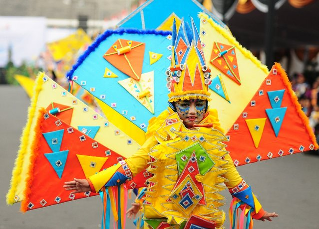 A model wears a Flying Kite costume in the kids carnival during The 13th Jember Fashion Carnival 2014 on August 21, 2014 in Jember, Indonesia. (Photo by Robertus Pudyanto/Getty Images)