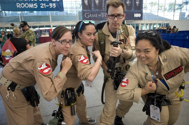 """Cosplayers dressed as characters from the 2016 movie """"Ghost Busters"""", pose for a photo during the Preview Night before the San Diego Comic Con 2016 in San Diego, California, USA, 20 July 2016. Comic Con runs from 21 until 24 July. (Photo by David Maung/EPA)"""