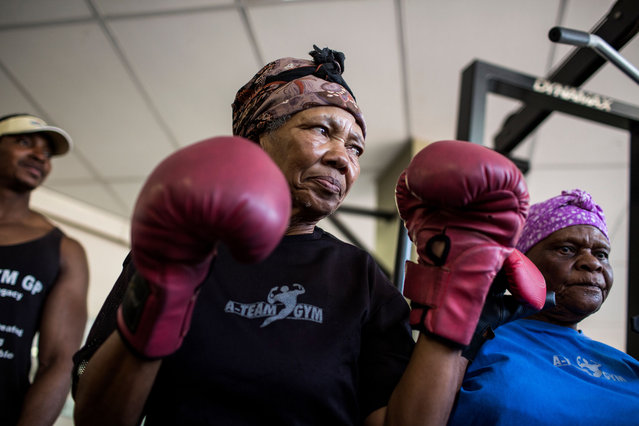 "77 year-old Gladys Ngwenya (C) prepare to take part in a ""Boxing Gogos"" (Grannies) training session hosted by the A Team Gym in Cosmo City in Johannesburg on September 19, 2017. (Photo by Gulshan Khan/AFP Photo)"
