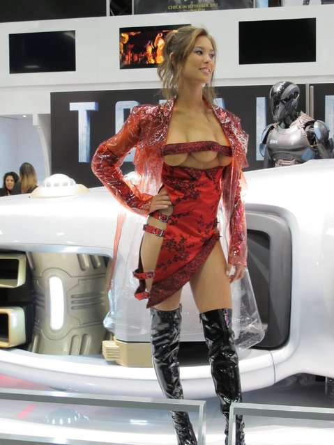 "Actress Kaitlyn Leeb poses in front of the ""Total Recall"" display as the three breasted woman in the Sony booth on Day 2 of Comic-Con International 2012 held at San Diego Convention Center on July 12, 2012 in San Diego, California. (Photo by Splash News and Pictures)"