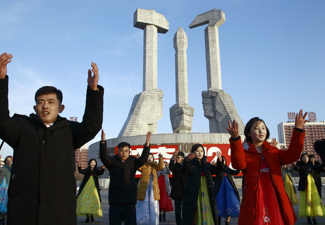 Locals participate in a public dance on the 28th anniversary of the start of Chairman Kim Jong Il's leadership of the Korean People's Army at the Monument to Party Founding in Pyongyang, North Korea, Tuesday, December 24, 2019. (Photo by Jon Chol Jin/AP Photo)