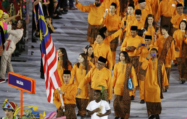 2016 Rio Olympics, Opening ceremony, Maracana, Rio de Janeiro, Brazil on August 5, 2016. Flagbearer Chong Wei Lee (MAS) of Malaysia leads his contingent during the opening ceremony. (Photo by Stoyan Nenov/Reuters)