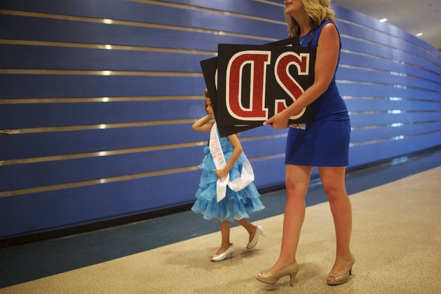 Miss South Dakota Little Sister Dakota Latinow, 6, arrives with her mother, Diana, at the first night of preliminaries of the Miss America Pageant at Boardwalk Hall in Atlantic City, New Jersey, September 8, 2015. (Photo by Mark Makela/Reuters)