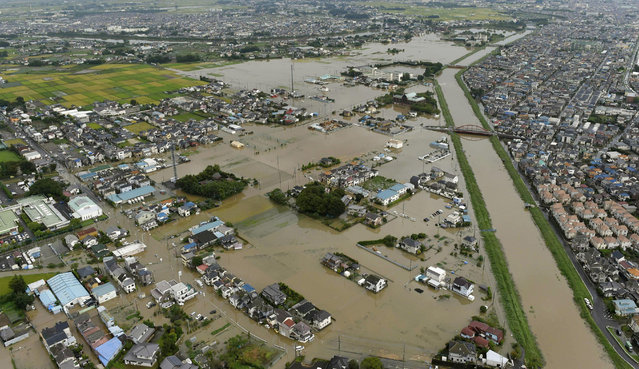 Houses are flooded due to heavy rain in Koshigaya, Saitama prefecture, near Tokyo Thursday, September 10, 2015. Heavy rain is pummeling Japan for a second straight day, overflowing rivers and causing landslides and localized flooding in the eastern part of the country. (Photo by Kyodo News via AP Photo)