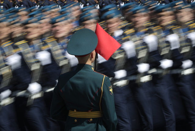 Russian soldiers march toward Red Square during the Victory Day military parade marking the 75th anniversary of the Nazi defeat in Moscow, Russia, Wednesday, June 24, 2020. The Victory Day parade normally is held on May 9, the nation's most important secular holiday, but this year it was postponed due to the coronavirus pandemic. (Photo by Pavel Golovkin/AP Photo/Pool)